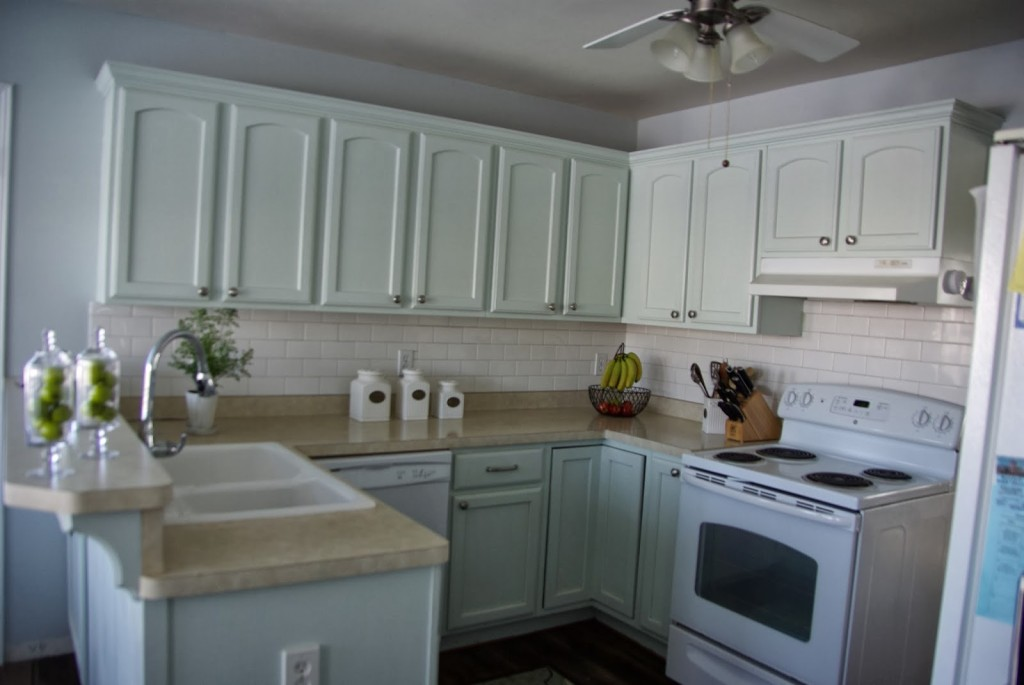 green kitchen with gray walls
