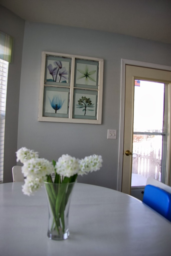 gray wall with white trim and old window pane picture frame