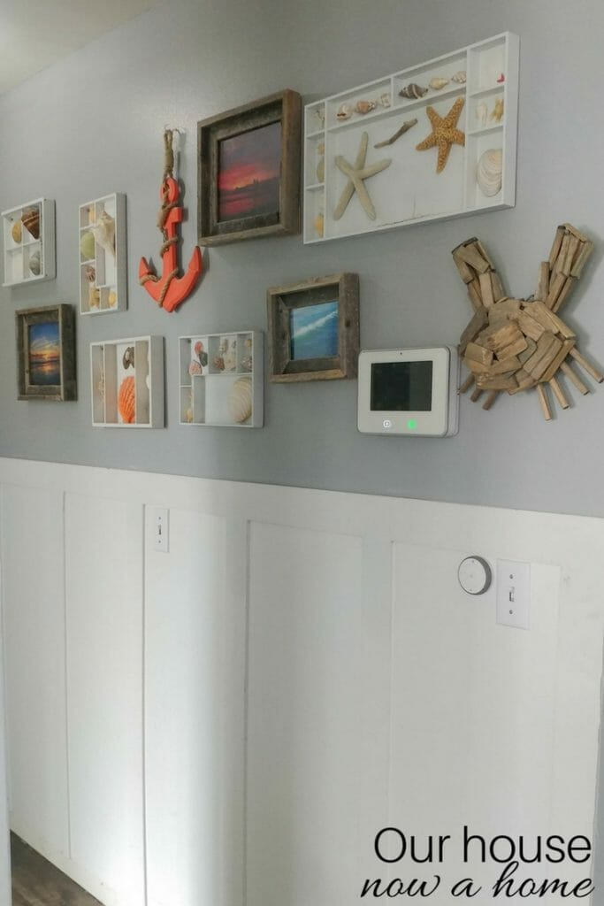 Coastal gray hallway with DIY ideas and wainscoting.