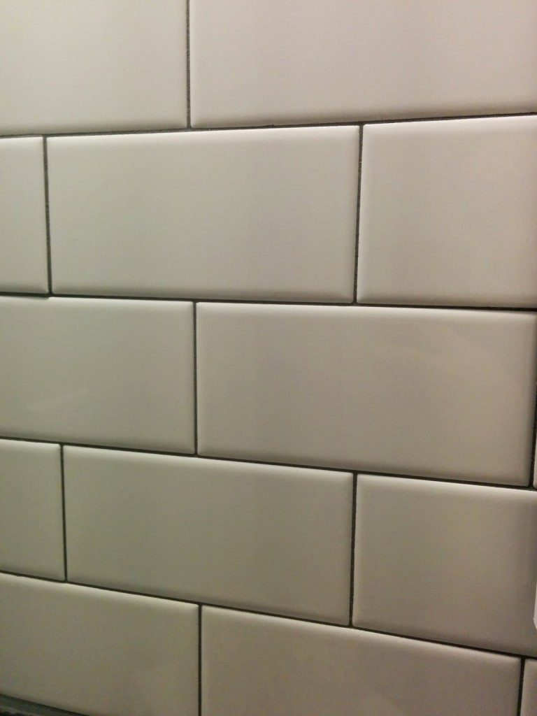 subway tile with dark gray grout line