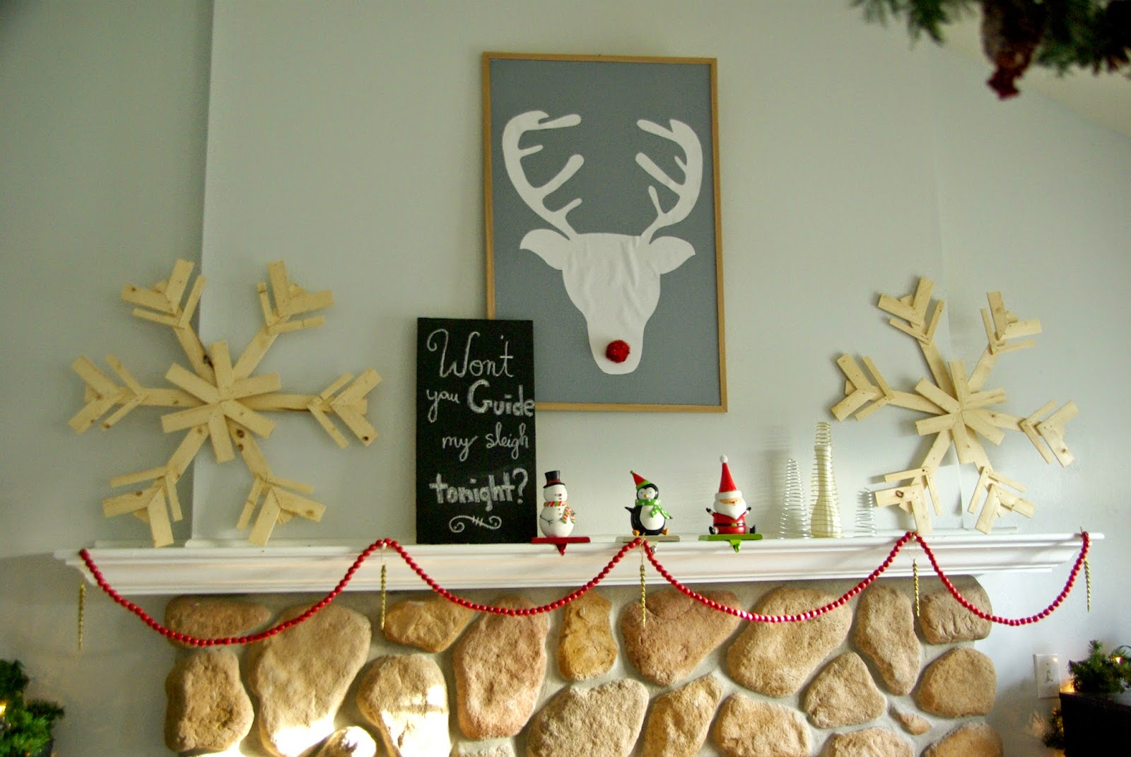 Rustic and whimsical Christmas fireplace mantel