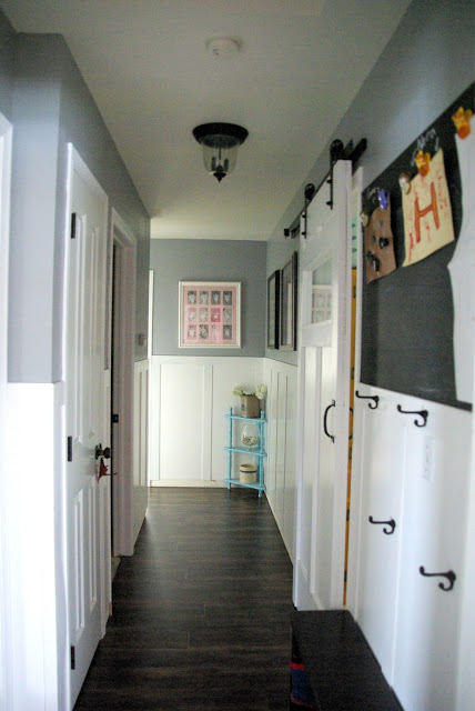 hallway with wainscoting