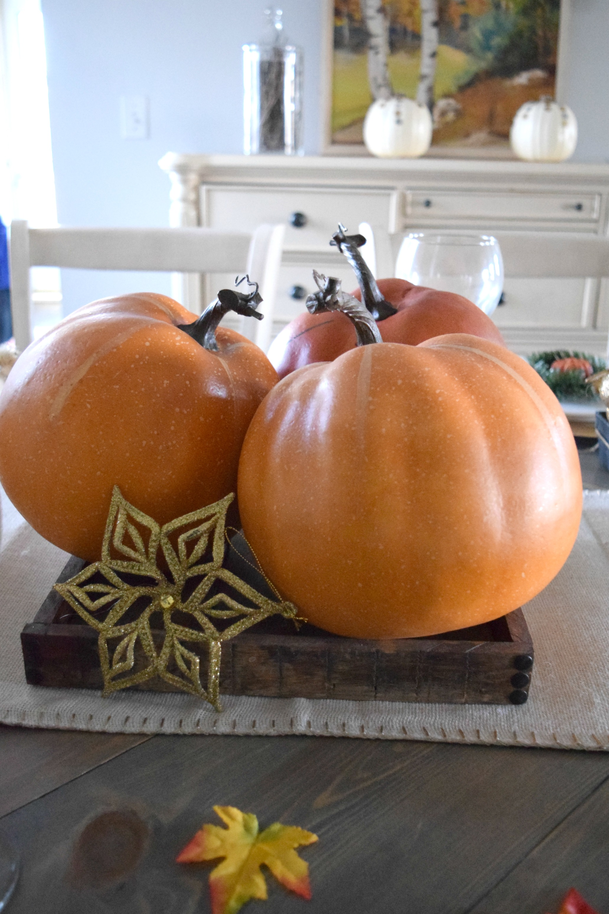 fake pumpkins on table