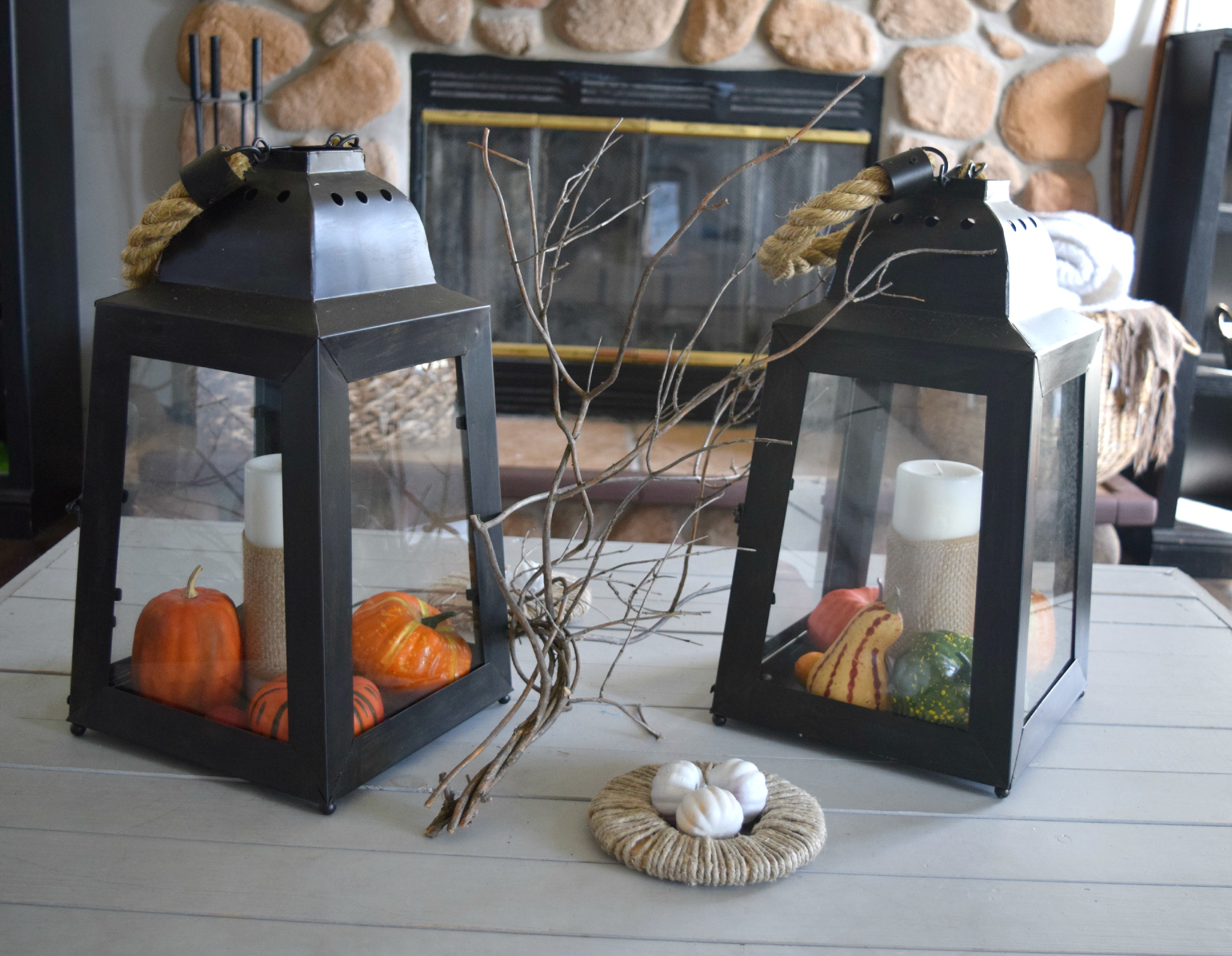 glass lanterns with fall decor