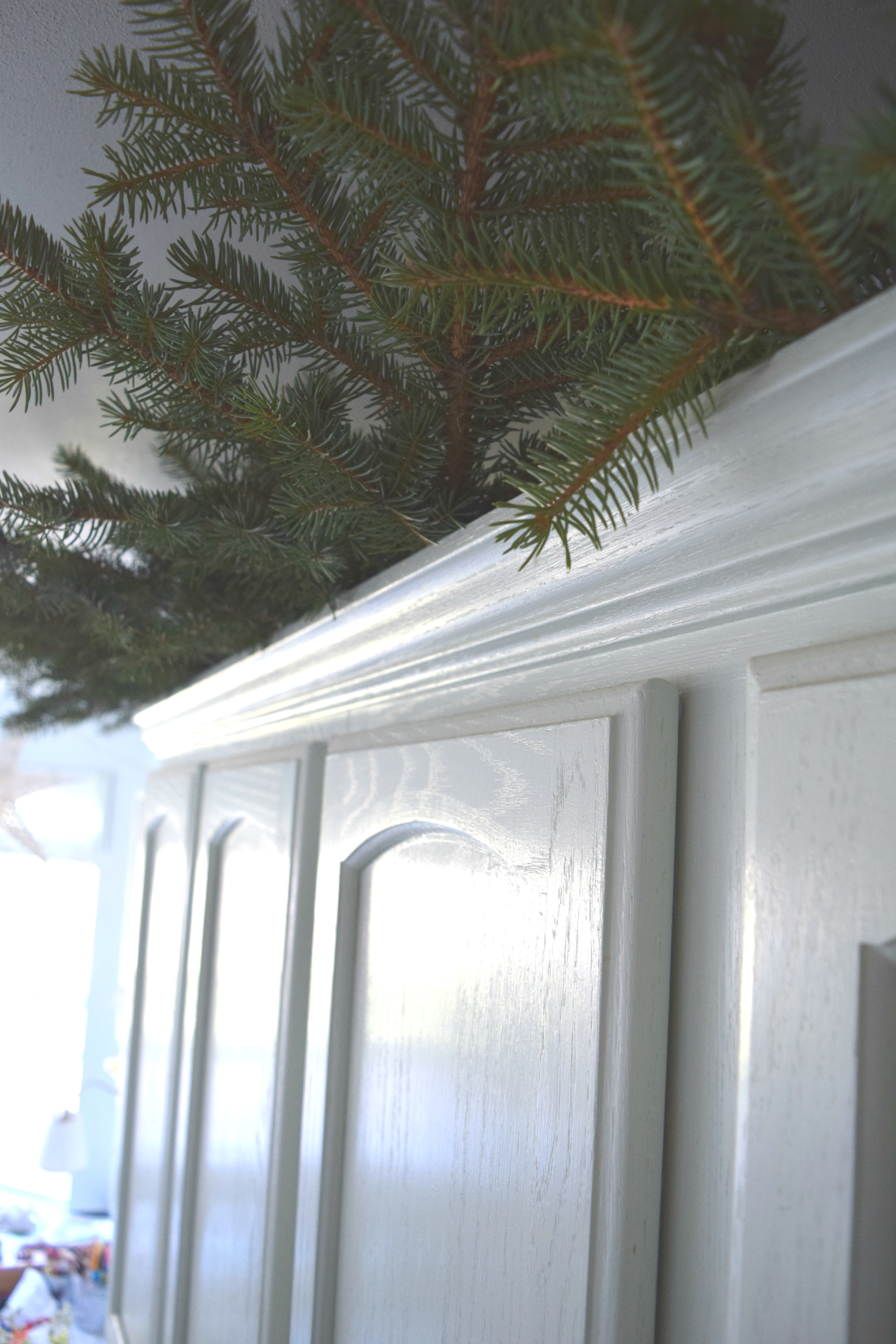 adding christmas greens to kitchen cabinets