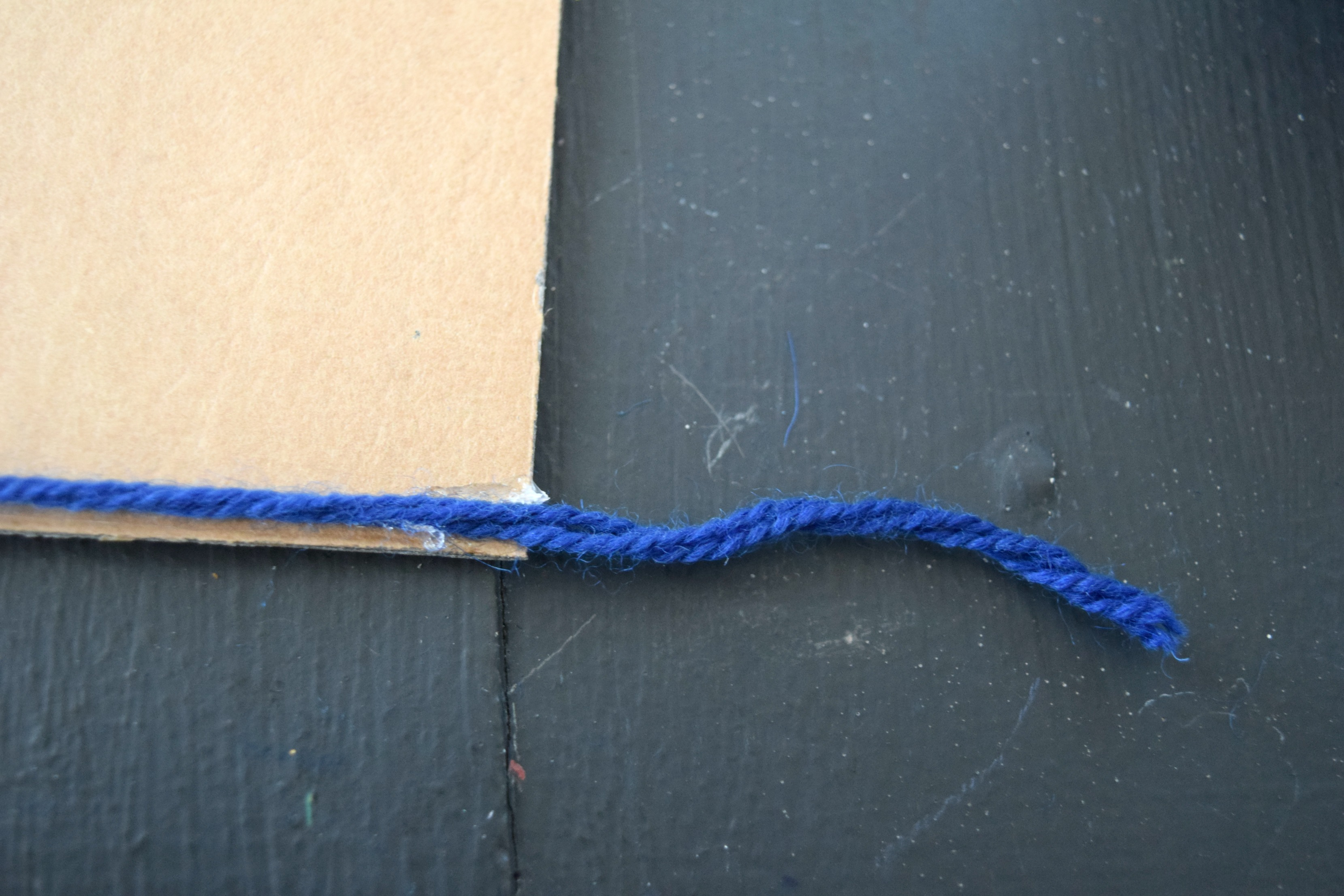 gluing yarn to picture