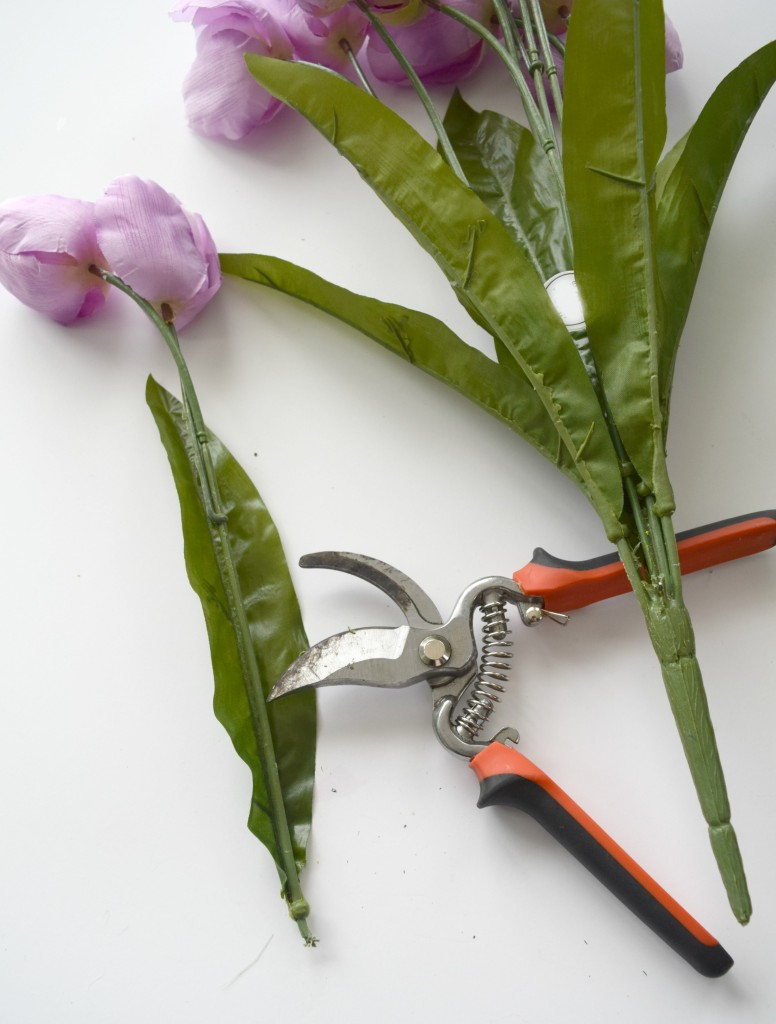 cutting fake flowers
