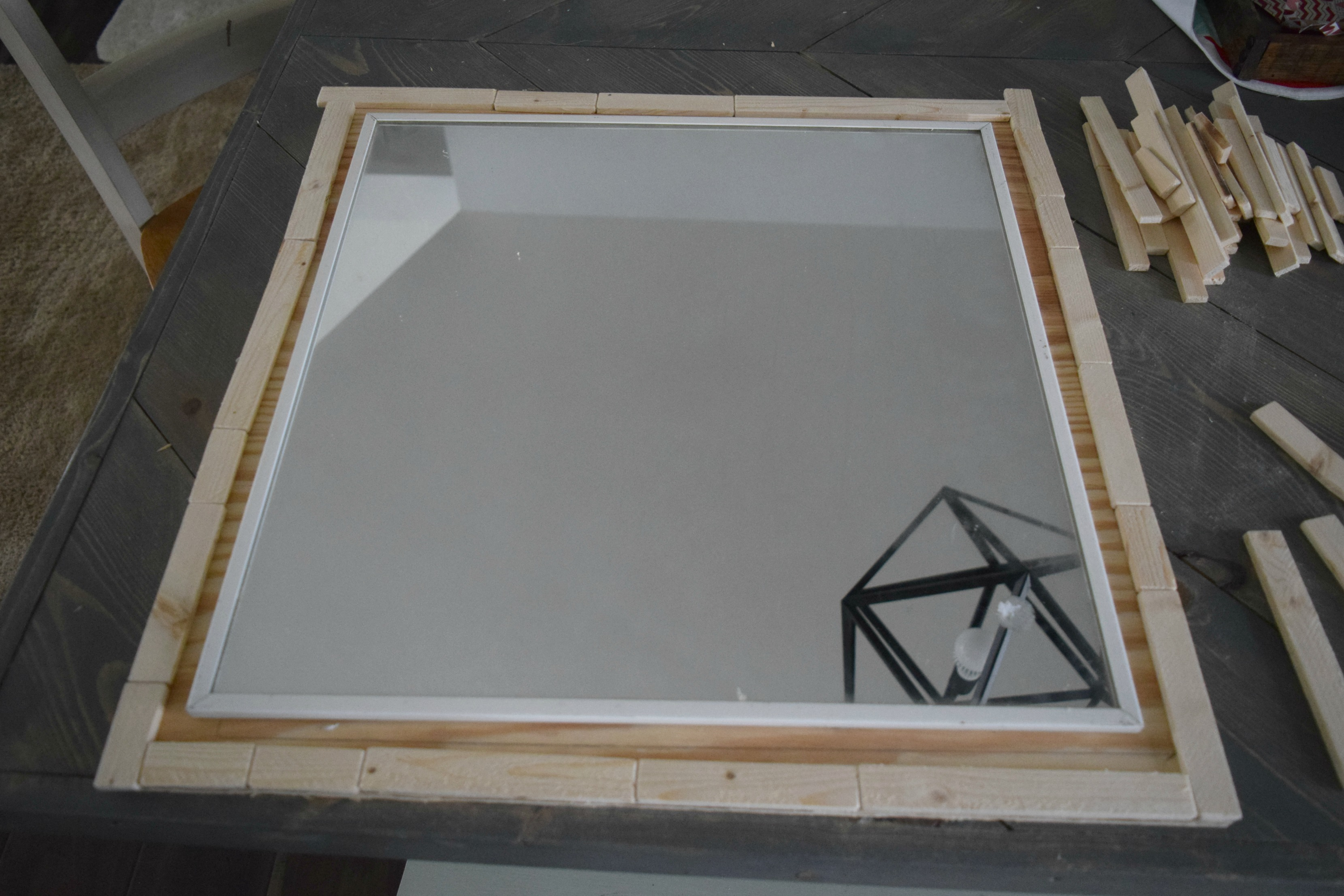 lining up wood mirror frame