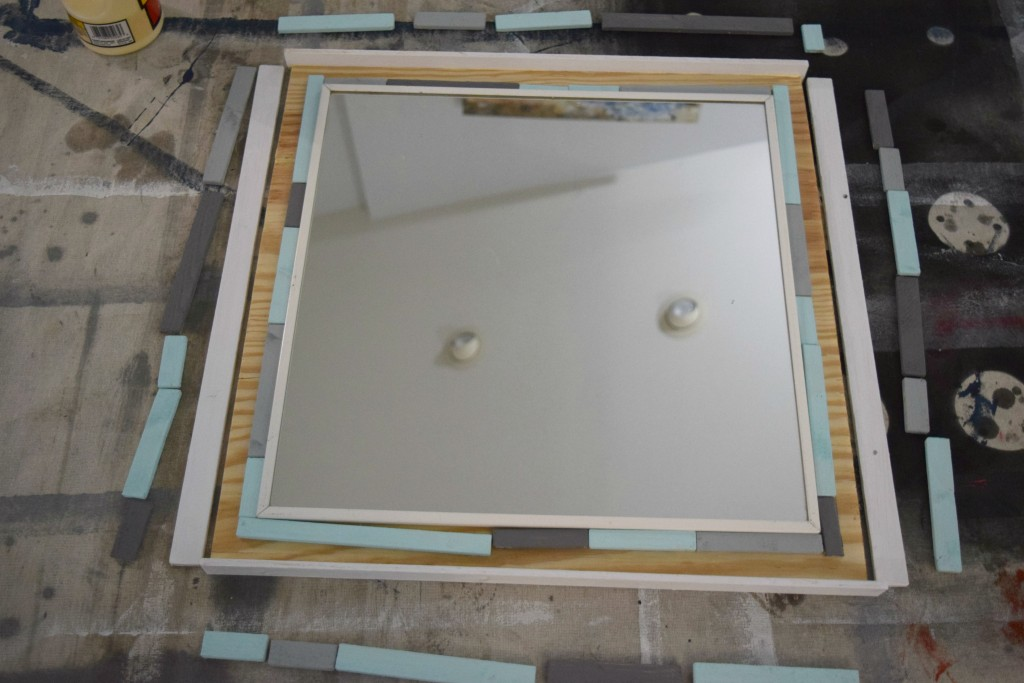 putting frame on mirror