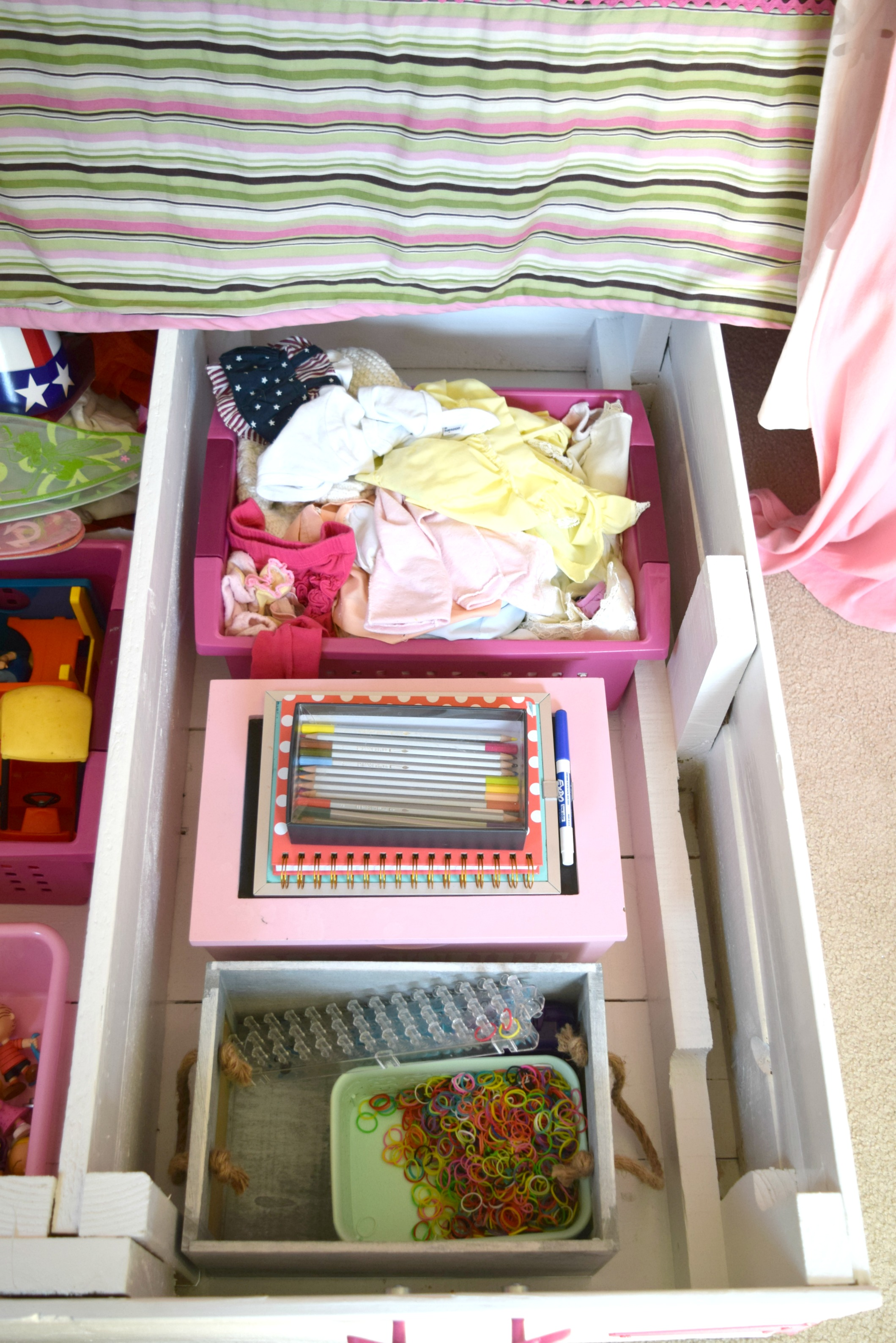 she is able to set in here her doll clothes art supplies and crafts