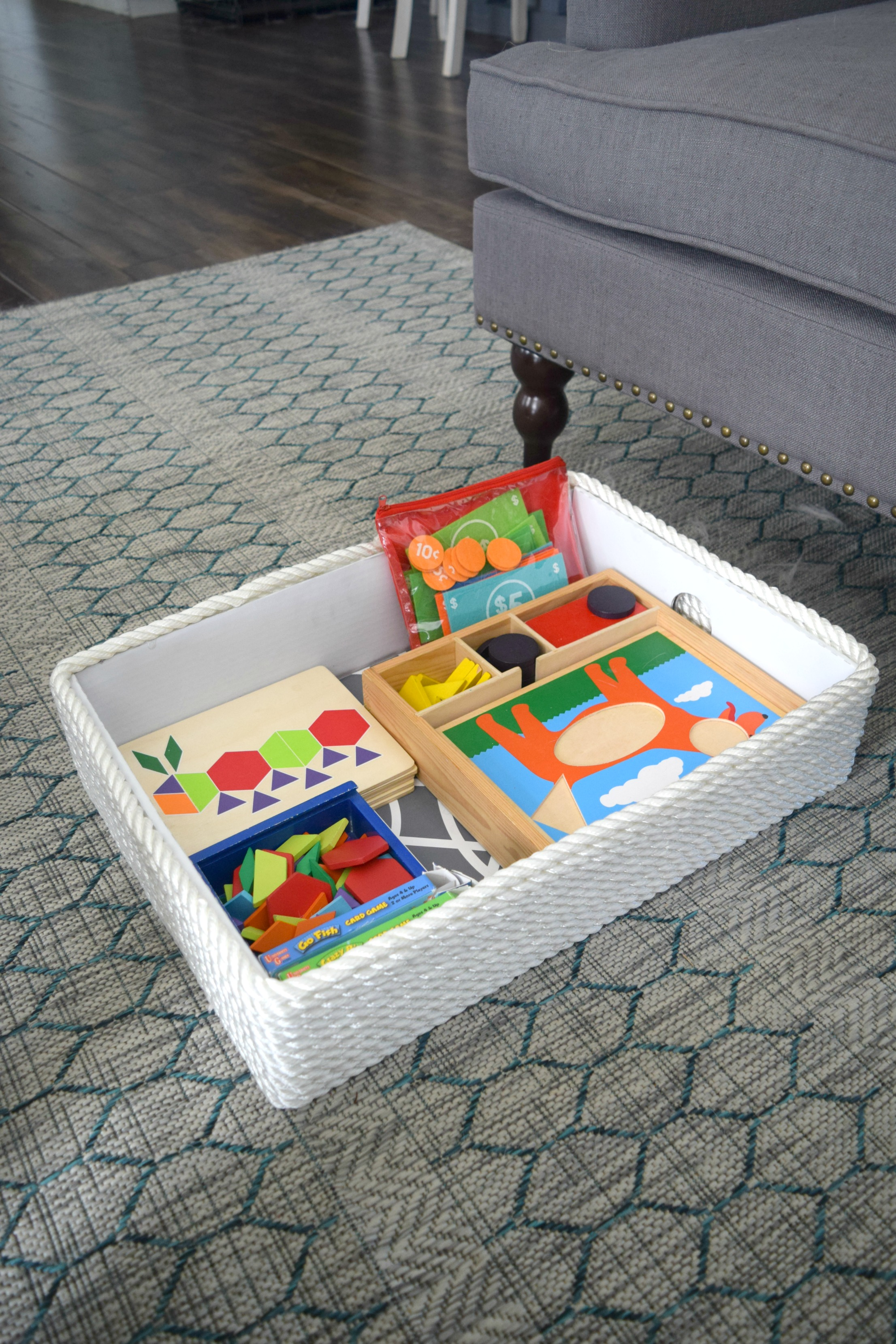 creating a simple storage bin using rope and a cardboard box our house now a home. Black Bedroom Furniture Sets. Home Design Ideas