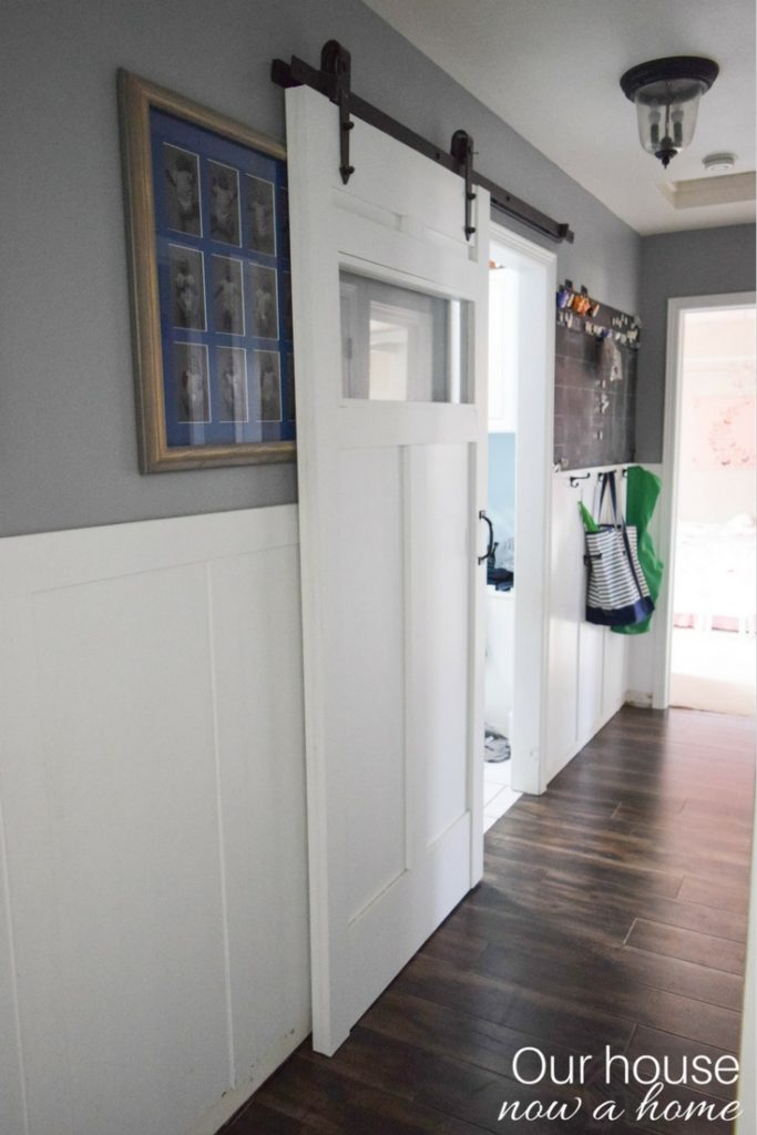 A sliding barn door is created to add function to this small space in a home