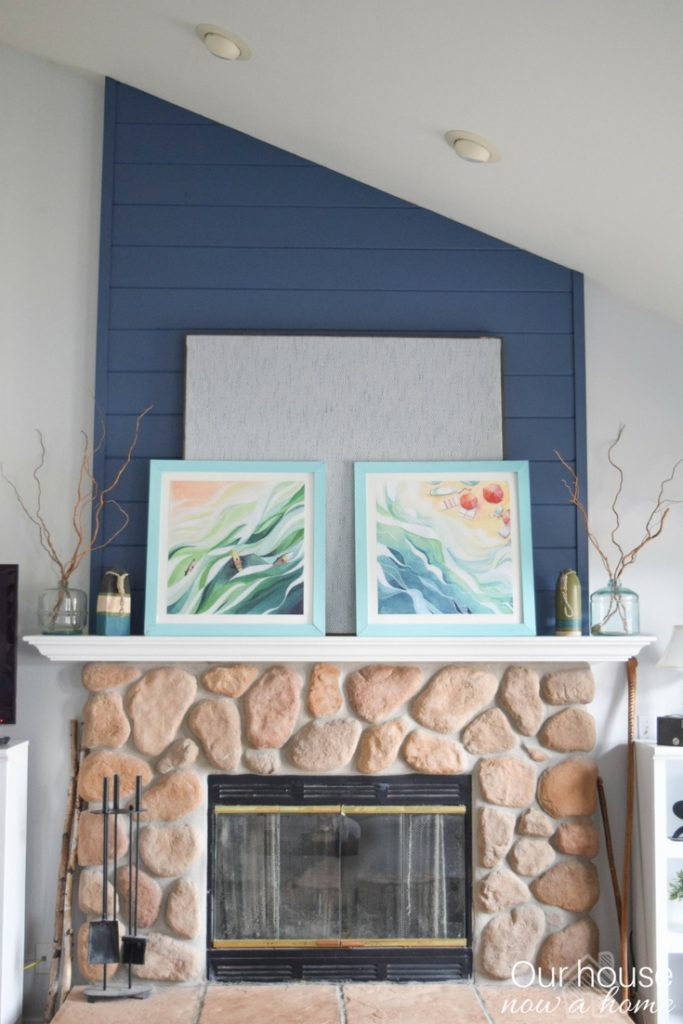 A coastal style home decorate the fireplace mantel with DIY projects and simple crafts. Keeping the decor low cost and full of California casual charm!