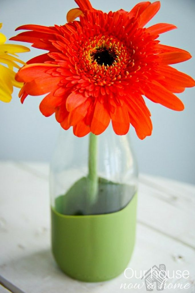 Glass drink container turned into cute drink or vase! Simple painting technique is used to create this fun and simple craft. Perfect pop of color for entertaining!