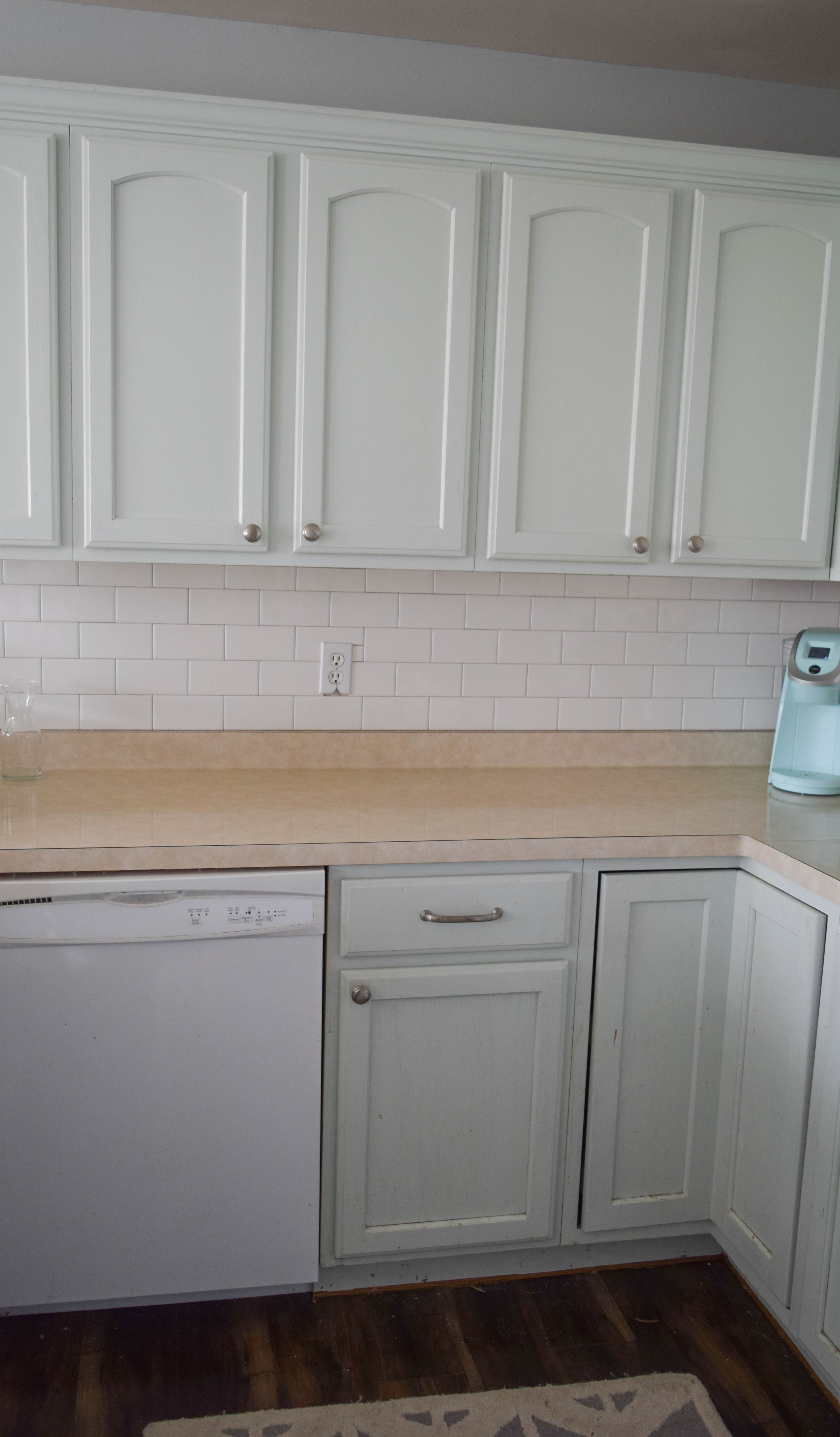 Painting Your Kitchen Cabinets Is No Small Undertaking: Improve A Small Kitchen With Small Updates And DIY Ideas