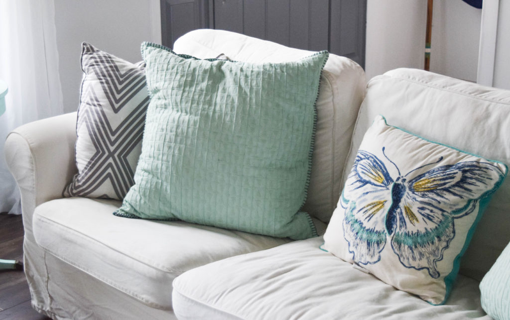 teal-and-gray-throw-pillows-with-geometric-patterns
