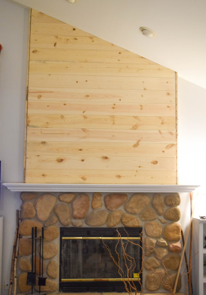 wood planks on fireplace feature wall