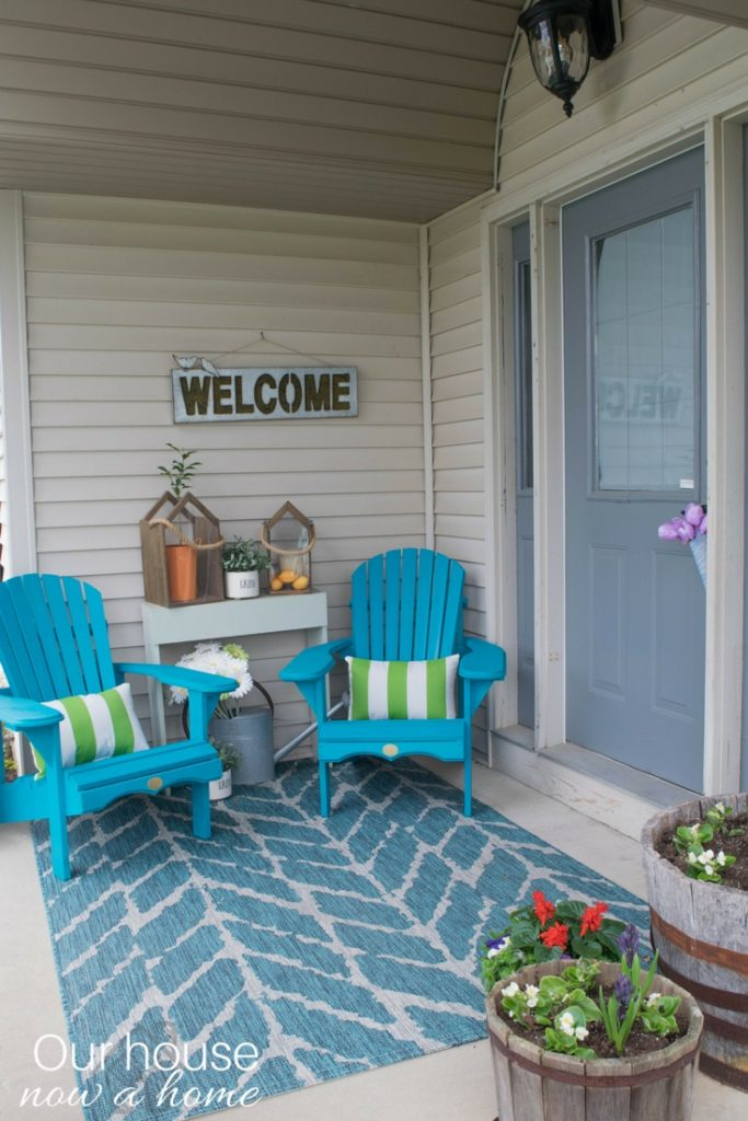 The perfect DIY wooden Adirondack chair. Painted a bold turquoise color, a great addition for a porch or patio for that outdoor living space.