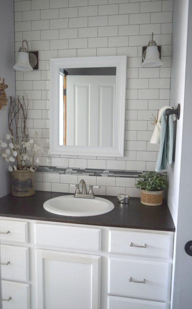 bathroom redo ideas. Low cost ways to renovate, using subway tiles and painting cabinet