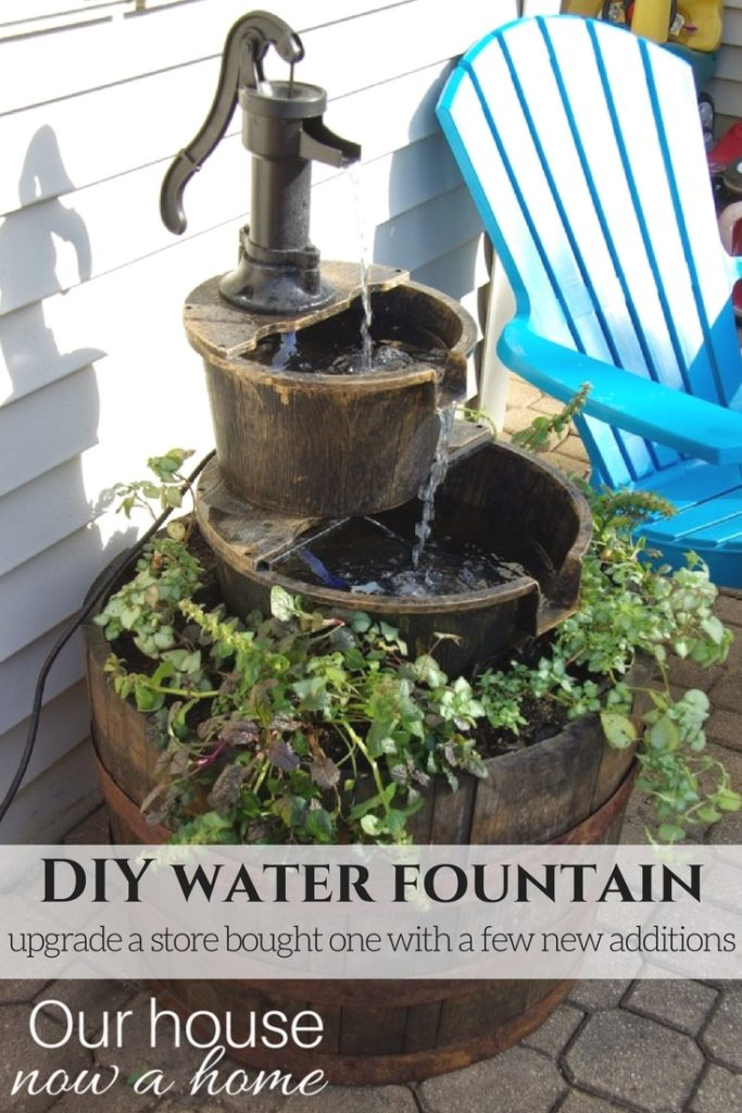 DIY water fountain, adding flowers and making the store bought water feature become a stand out for the outdoor space.