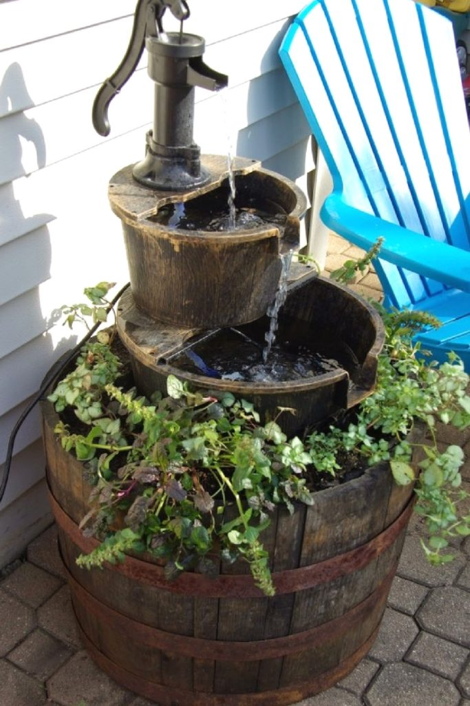 How to upgrade a store bought outdoor water fountain. Without spending a ton of money this water fountain is improved and becomes a beautiful outdoor feature and planter.