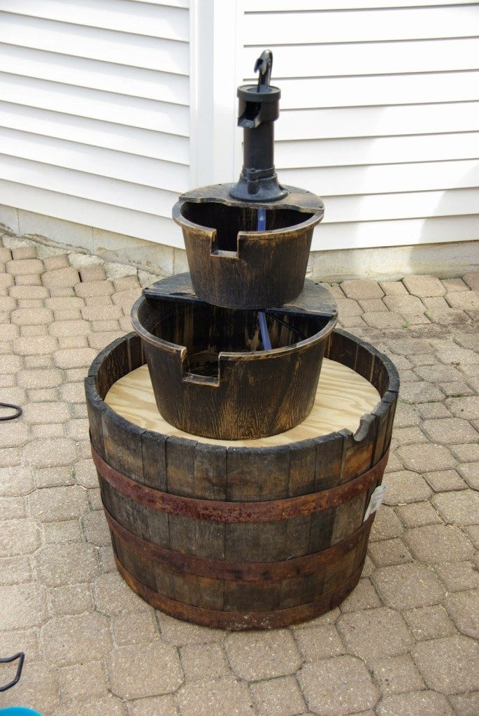 store bought water fountain gets turned into large water fountain. A show piece for any outdoor space!