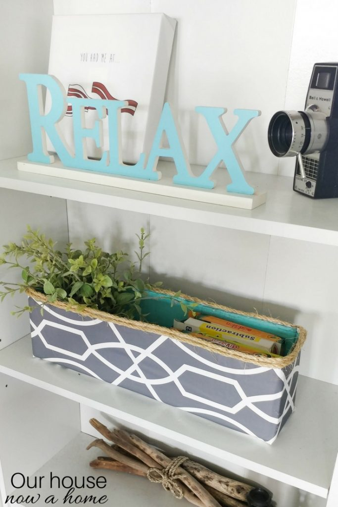 DIY cardboard box upcycle. Low cost and cute way to make a decorative storage bin. Hide those toys or gain storage in the home.
