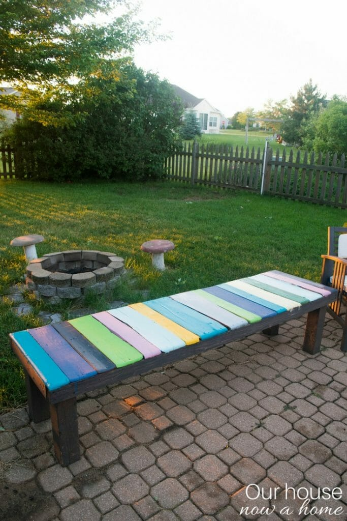 DIY wood pallet bench. Low cost and simple way to add color to your outdoor space.