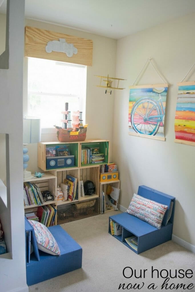 Simple ways to make a reading nook for a child's bedroom or play room. Low cost crate bookshelf, simple DIY