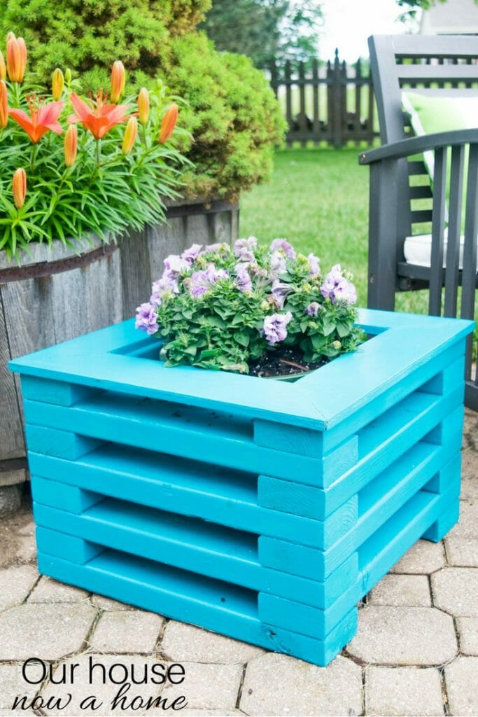 DIY flower planter using low cost 2x4 wood boards. Simple to make with amazing results! Perfect for any outdoor space.