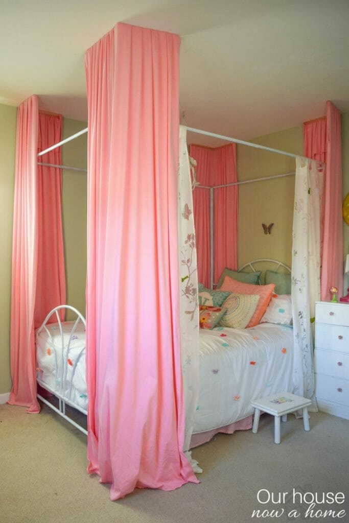 Girl canopy bed with DIY floor to ceiling bed curtains