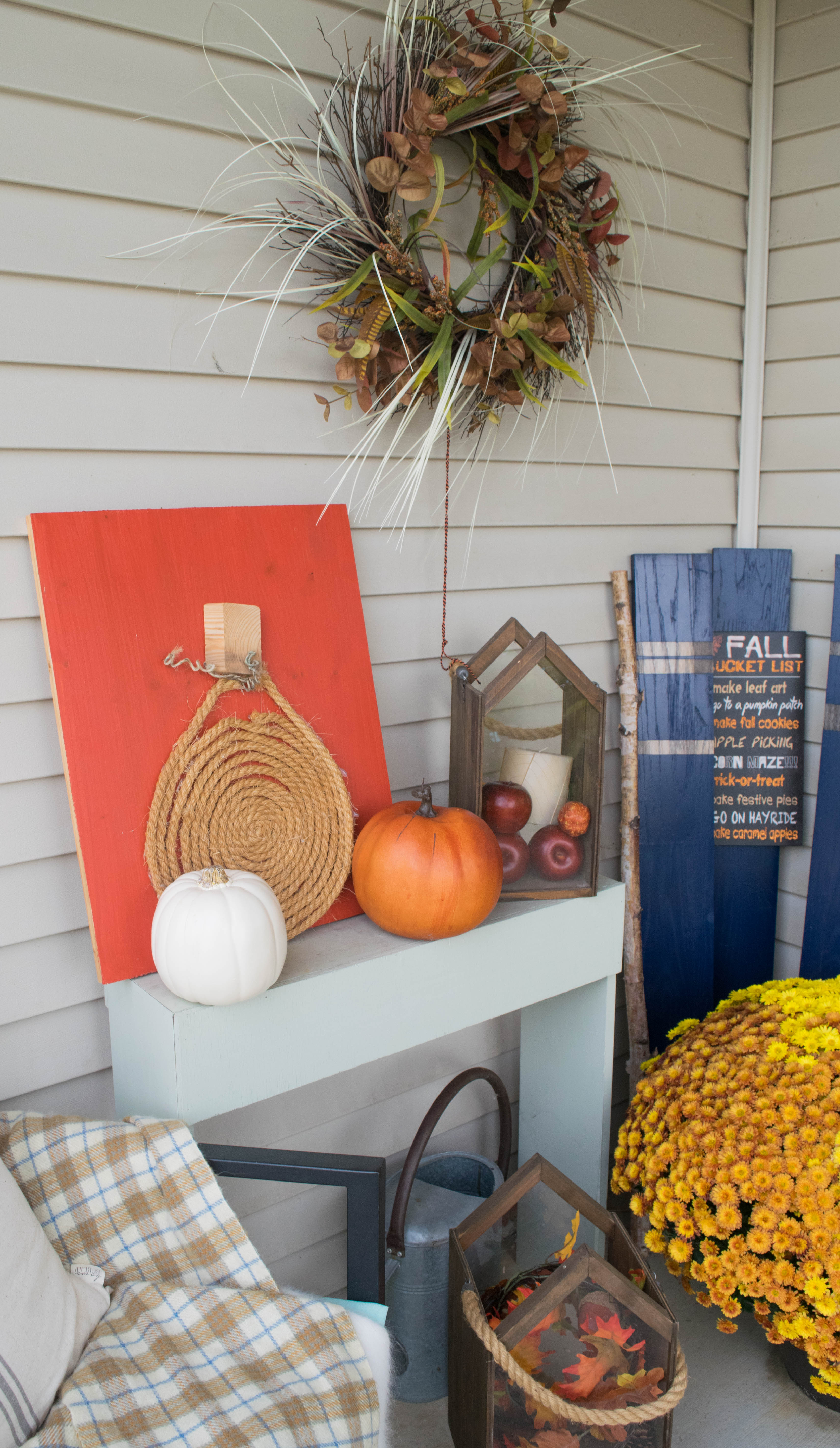Fall front porch a mix of diy and rustic decor our for Orange and blue decorating ideas