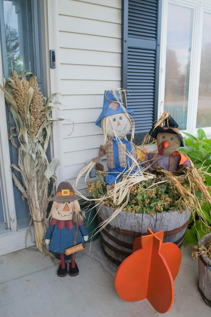 Fall front porch a mix of diy and rustic decor our for Scarecrow home decorations co ltd