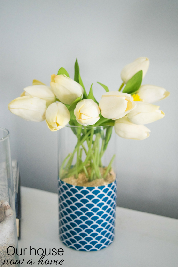Simple decorating ideas our house now a home for this little vase i switched up my standard wrapped vase i only wrapped the bottom half of it in paper then i rolled up a small towel and put it in reviewsmspy