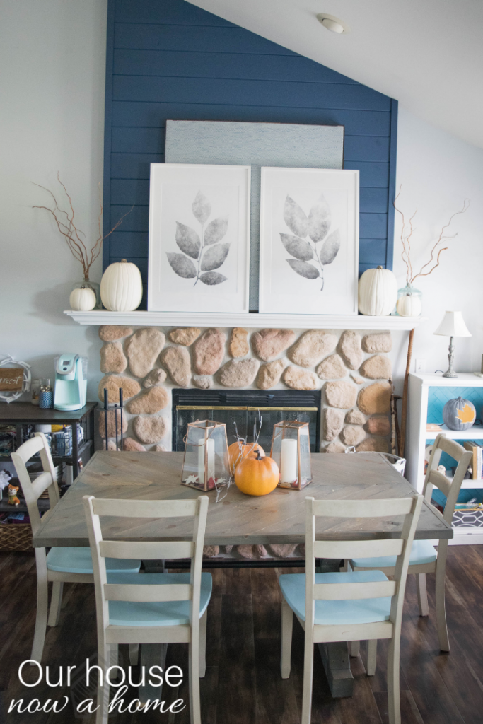 Beautiful fall dining room with fireplace! Rustic, low cost, simple, easy, and bold fall decor ideas.